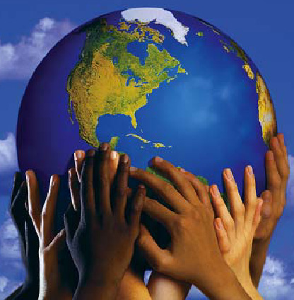 Different colored children's hands holding a globe